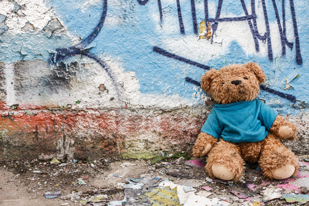 Teddy bear of homeless child left on the ground