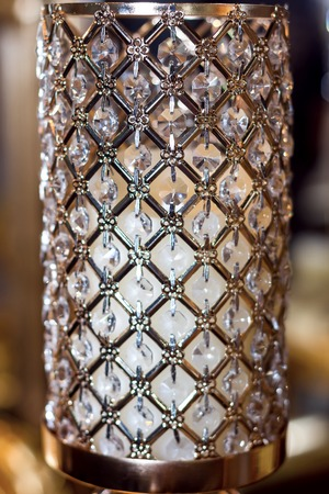 Crystal lamp shade decorated with strass.