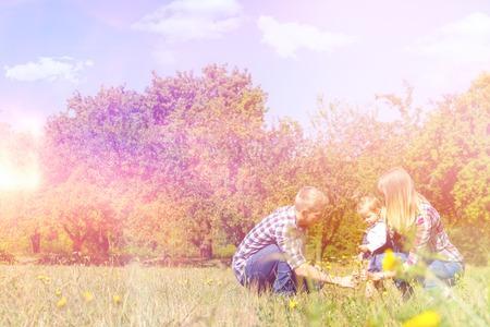 enjoying life: Happy family enjoying life together gathering flowers Stock Photo