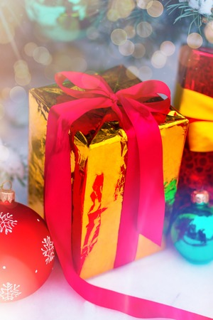 Close up shooting of several presents wraped up in colorful paper lying under the christmas tree