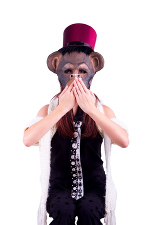 Young woman wearing mask of the monkey gesturing Dont speak