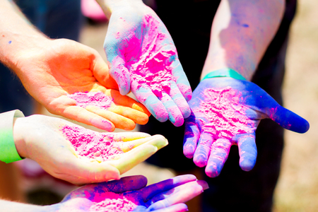 Close up shooting of  hands holding colorful powder for Holi celebration Stock Photo