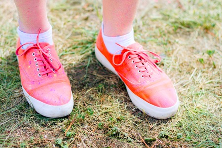 Body parts.Close-up shooting of girls feet wearing pink sneakers