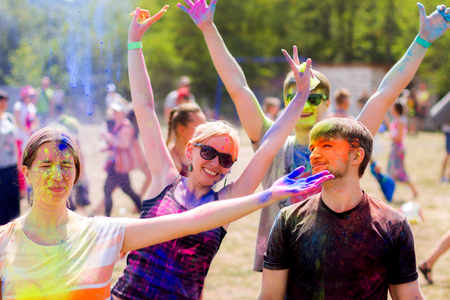 Young people preparing for throwing colorful powder during Holifest Stock Photo