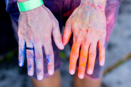 Body parts.Close-up shooting of boys legs wearing shorts stained with colorful powder