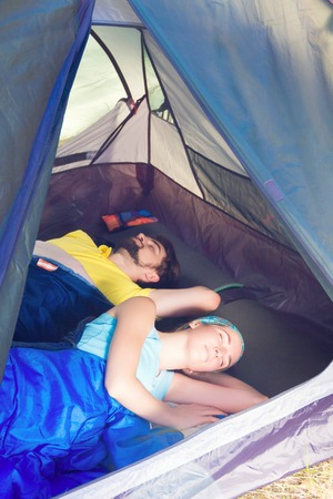 sustainable tourism: Couple of tourists  sleeping in the tent.