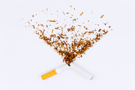 Broken cigarette and tobacco isolated on white background