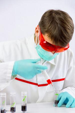 Scientist testing gmo plants in biological laboratory