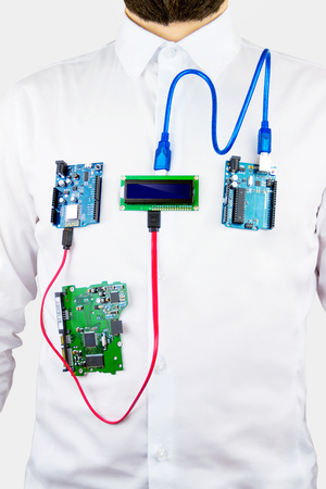 Virtual organs concept. Microcontrollers and chips connected to the body of a man simulating organs activity Stock Photo