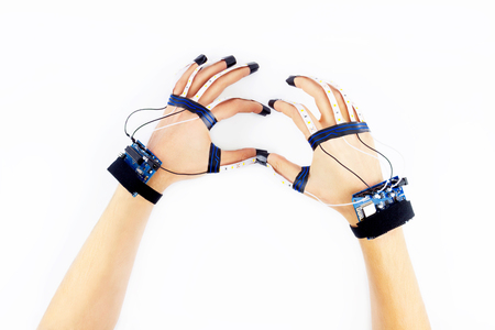 microprocessor: Virtual reality. Engineer working in virtual gloves. Microcontrollers connected to the fingers of engineer showing circle