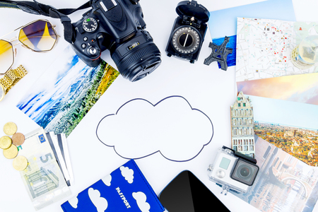 Planning of travelling concept.  Top view of essentials for modern young person. Objects of a traveller isolated on white background: compass, sunglasses,  map, passport, camera, cash,  smartphone, film,  souvenirs, watch, photos of Italy, Carpathians and