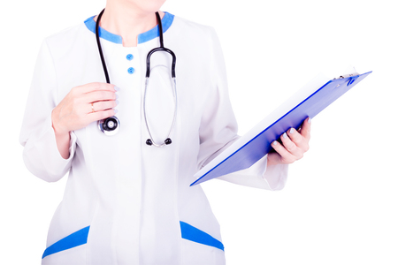 Close-up of doctors hands holding a clipboard with patients medical records
