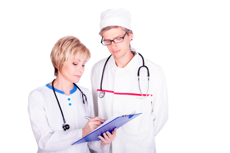 Professional doctors wearing stethoscopes checking patients medical records