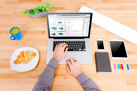 Software  Cad engineers workplace with laptop with math formulas and graphs, tablet and smartphone. Note: Code was got from github with free license for commercial use (MIT) Stock Photo