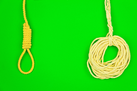 millimeter: Yellow strings put in circle isolated on green background