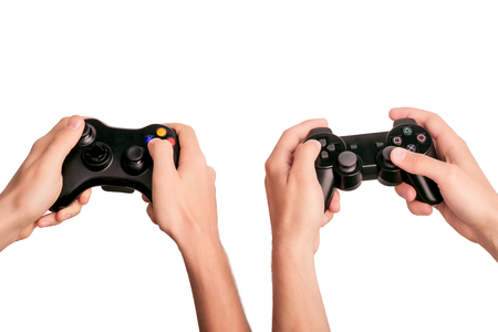 Men's hands holding gamepads isolated on white background