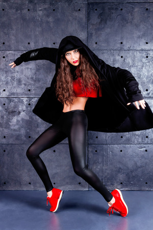 rnb: Girl dancing in front of the urban wall.