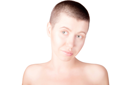 Portrait of positive woman with bald haircut with bare shoulders on isolated white background  Stock Photo