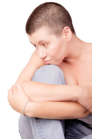 Sad woman with bald haircut with bare shoulders on isolated white background  Stock Photo
