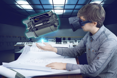 Virtual reality in engineering concept. Male  man engineer wearing shirt and vr glasses working with holographic engine for mechanic industry and analyzing sketches on futuristic plant background with control panels.