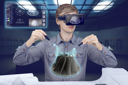 Virtual reality in engineering concept. Male  man wearing shirt and vr glasses holding screwdrivers fixing holographic model of turbine and looking at virtual screen analyzing 3d data for mechanic industry on futuristic plant background with control panels. Banco de Imagens