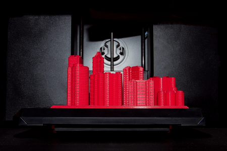 Red 3D printed city as example of possibility 3D printers in production industry in black metal background. Company growth, managment concept