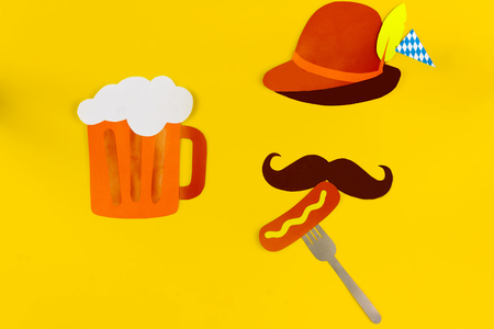 Germany face silhouette with bavarian brown hat, mustache eating sousage with mustard on fork with huge glass of beer. Ads event of october beer festival in autumn october month