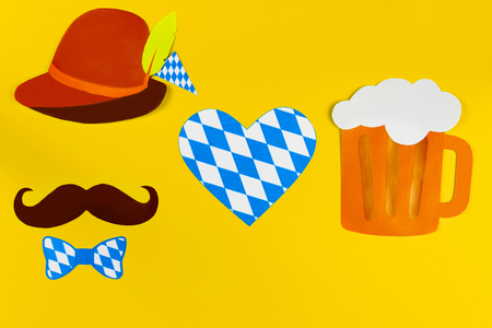 Germany face silhouette with bavarian brown hat and tie bow, mustache heart in blue white color and beer symbolizes