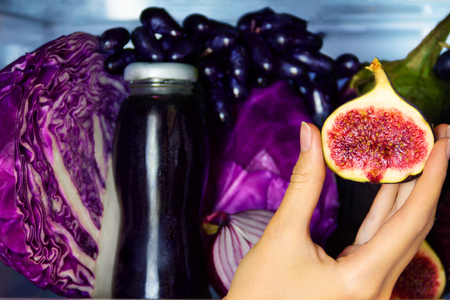 Summer violet healthy organic antioxidant fig, veggies vegetables and fruits: cabbage, eggplant, grape, onion as symbol of healthy eating, diet and lifestyle. Fridge, vegan. vegetarian and raw concept