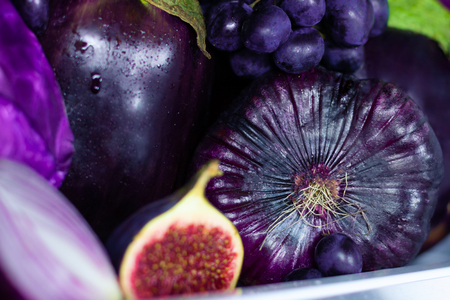 Closeup of summer violet healthy organic antioxidant veggies vegetables and fruits: onions, eggplants and figs as symbol of healthy eating, diet and lifestyle. Fridge, vegan vegetarian and raw concept Stock Photo