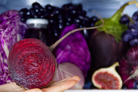 Summer violet healthy organic antioxidant beet, veggies vegetables and fruits: cabbage, onion, grape, fig as symbol of healthy eating, diet and lifestyle. Fridge, vegan, vegetarian and raw concept