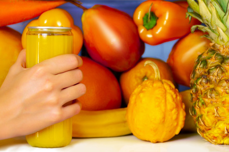 Summer yellow healthy organic antioxidant orange juice, veggies vegetables and fruits: pumpkin, pear orange as symbol of healthy eating, diet and lifestyle. Fridge, vegan. vegetarian and raw concept Stock Photo
