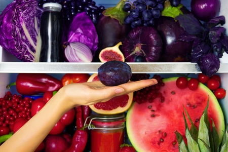 Summer violet healthy organic antioxidant plump, veggies vegetables and fruits: cabbage, eggplant, grape, fig as symbol of healthy eating, diet and lifestyle. Fridge, vegan, vegetarian and raw concept