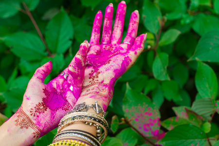 Woman Smeared Hands With Henna Tattoo And Bracelets Jewelry Colorful ...