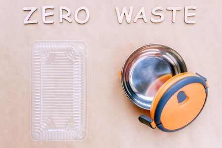 Reusable sustainable stainless steel food container compare to plastic one isolated on brown craft fabric background. Refuse, reduce, recycle and zero waste concept. Ecology, cut plastic footprint.