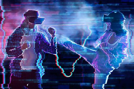 Girl and boy are playing in virtual reality game club. Young woman and man in VR glasses are gaming. Opponents are fighting in simulator. Entertainment and leisure concept. Modern technologies. Stockfoto