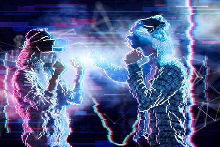 Girl and boy are playing in virtual reality game club. Young woman and man in VR glasses are gaming. Opponents are fighting in simulator. Entertainment and leisure concept. Modern technologies.