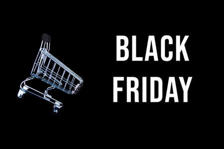 Little shopping cart, trolley for clothes, products, technics, gifts on background canvas. Black friday sale, cyber monday concept. Seasonal discount. Hot low price. Best deal offer to buy goods.