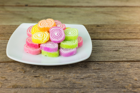 gummy: Gummy candies stretched on wood .