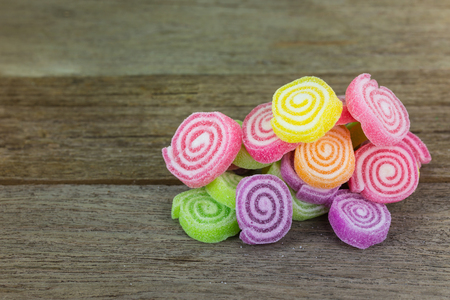 sweetest: Gummy candies stretched on wood .