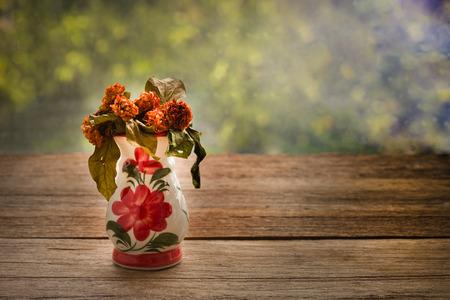 woo: Dried Jasmine flowers in a vase