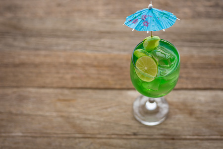 cocktail strainer: margarita cocktail with salty rim on wooden table with limes Stock Photo