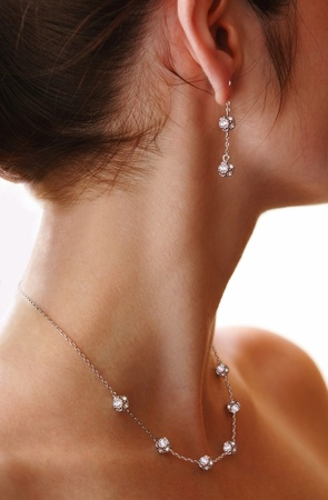 closeup of female neck with jewelery