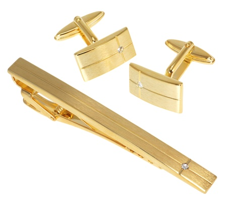 golden cuff link and tie pin isolated on white Stock Photo - 9574470