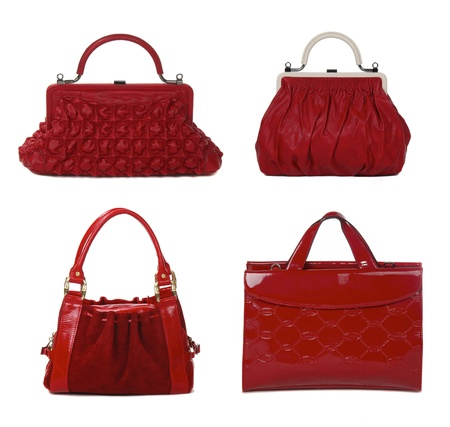 set of red leather female bags isolated on white