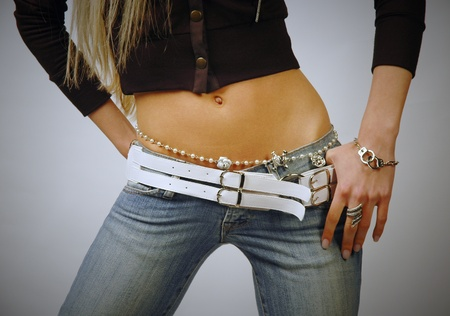 beautiful navel women: Fit woman belly wearing jeans and bijouterie