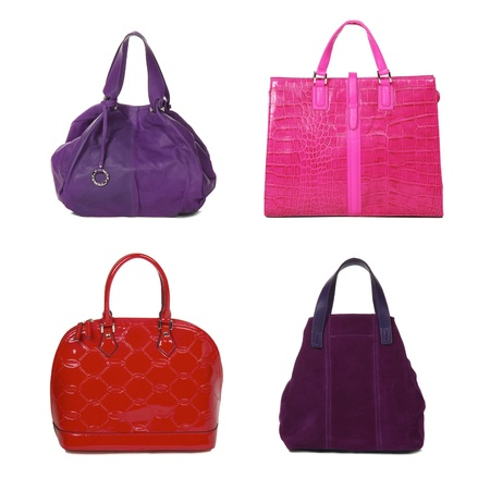set of female bags of different color isolated on white