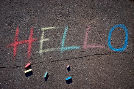 the inscription hello drawn on asphalt with chalk Stock Photo