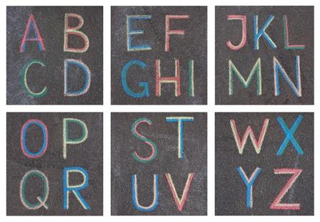 Alphabet letters drawn on asphalt with chalk, a, b, c, d photo