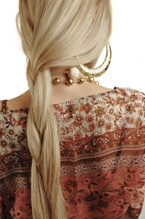 Plait of a young blond girl. Woman back with braided hair. photo